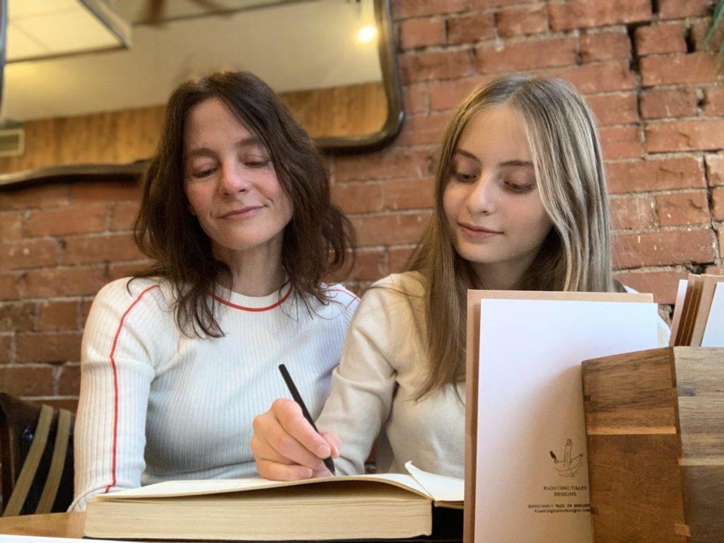 greeting card artists Belgin and Belisa making drawings in a sketchbook